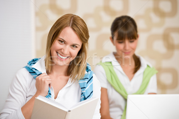 Student at home - two woman with book and laptop Stock photo © CandyboxPhoto