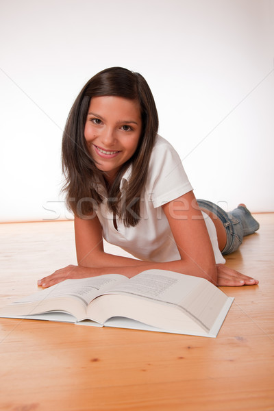 Brown hair teenager lying on wooden floor  Stock photo © CandyboxPhoto