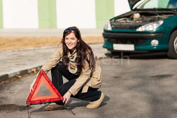 Woman putting warning triangle on the road Stock photo © CandyboxPhoto