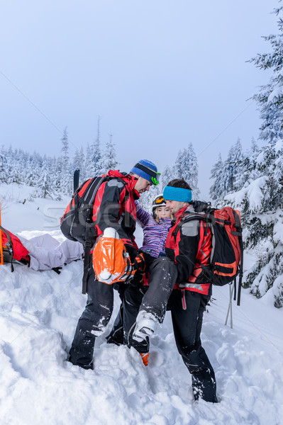 Ski patrol carry injured woman skier stretcher Stock photo © CandyboxPhoto
