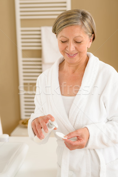 Senior woman bathroom apply face make-up removal Stock photo © CandyboxPhoto