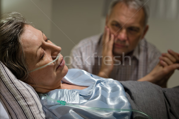 Sick mature woman lying in bed Stock photo © CandyboxPhoto