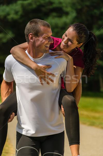 Mosolyog férfi háton barátnő közelkép portré Stock fotó © CandyboxPhoto