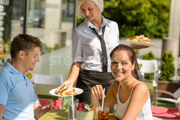 Waitress bring couple lunch food restaurant terrace Stock photo © CandyboxPhoto