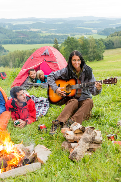 Camping friends lying tents girl playing guitar Stock photo © CandyboxPhoto