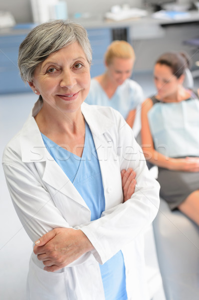 Profissional dentista mulher paciente cirurgia dentária cirurgião Foto stock © CandyboxPhoto