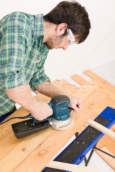 Stock photo: Home improvement - handyman sanding wooden floor