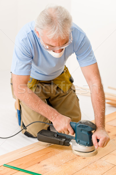 Home improvement - handyman sanding wooden floor  Stock photo © CandyboxPhoto