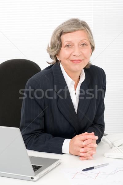 Senior imprenditrice sedersi dietro di successo Foto d'archivio © CandyboxPhoto
