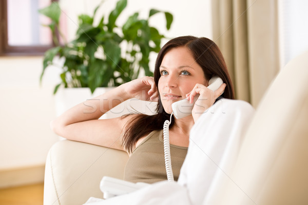 Stock photo: On the phone home: woman calling