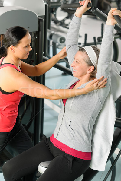 Senior woman at fitness center with trainer Stock photo © CandyboxPhoto