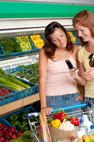 Grocery store shopping - Two women with mobile phone Stock photo © CandyboxPhoto