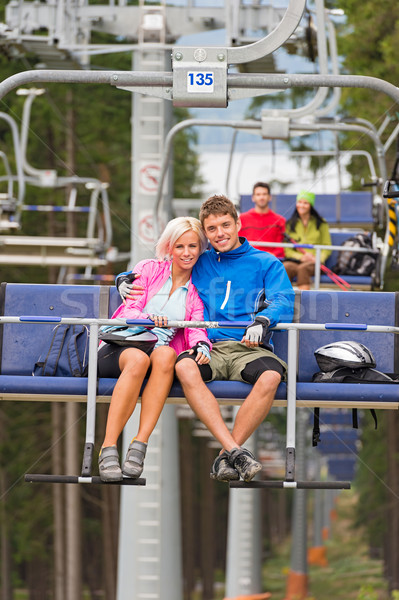 Cuddling young couple sitting on chair lift Stock photo © CandyboxPhoto