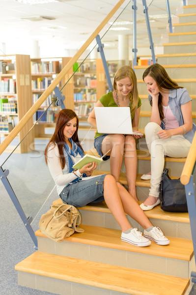 Csoport középiskola osztálytársak tanulás könyvtár három Stock fotó © CandyboxPhoto