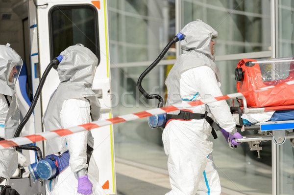 Hazardous material medical team entering building Stock photo © CandyboxPhoto