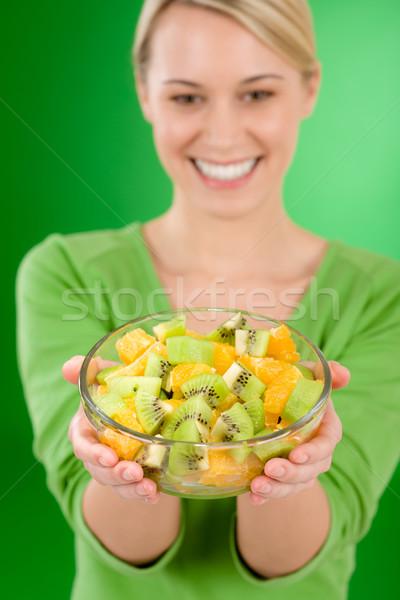 Healthy lifestyle - woman holding fruit salad bowl Stock photo © CandyboxPhoto