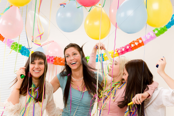Stock photo: Birthday party celebration - four woman with confetti have fun