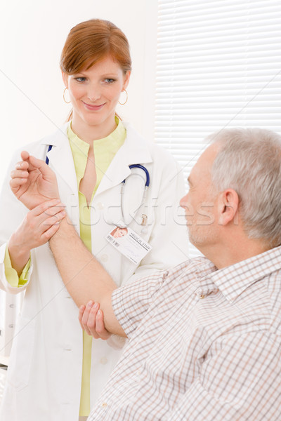 Doctor office - female physician examine patient Stock photo © CandyboxPhoto