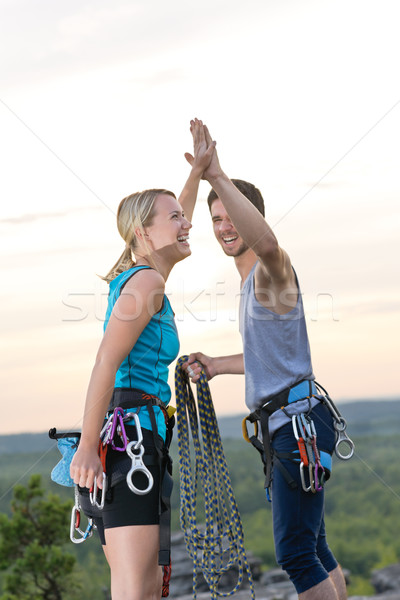 Rock climbing cheerful alpiners on top sunset Stock photo © CandyboxPhoto