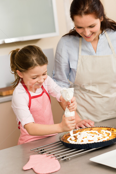 Stock photo: Decorating apple pie mother and daughter