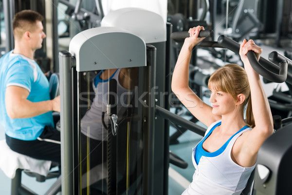Two people at fitness center exercise machine Stock photo © CandyboxPhoto