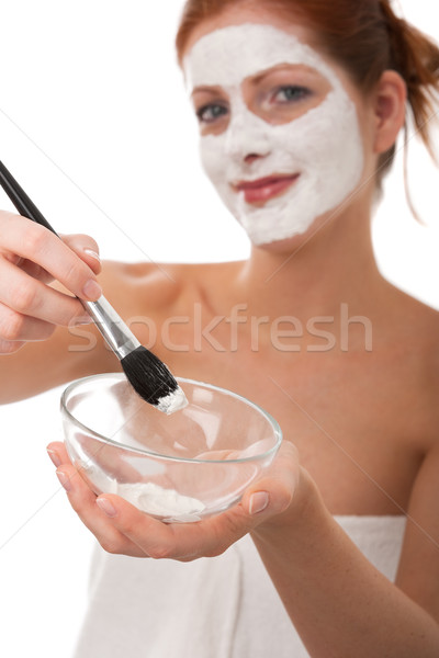 Stock photo: Body care series - Young woman applying white facial mask