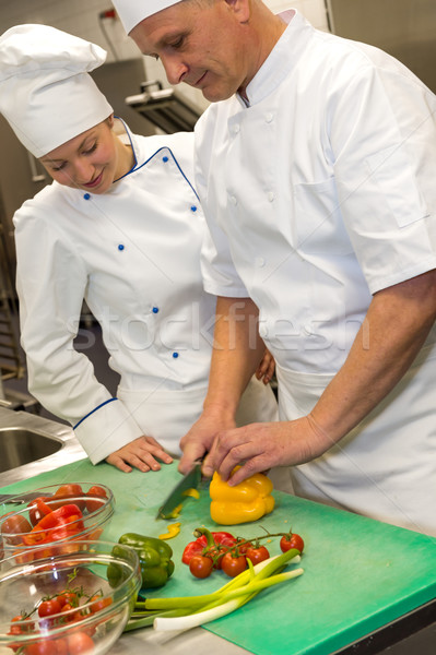 Apprentice learning cutting vegetables from chef  Stock photo © CandyboxPhoto