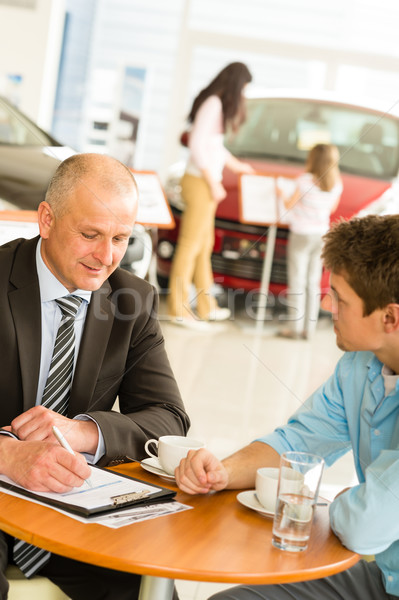 Buying family car Caucasian salesman with customer Stock photo © CandyboxPhoto