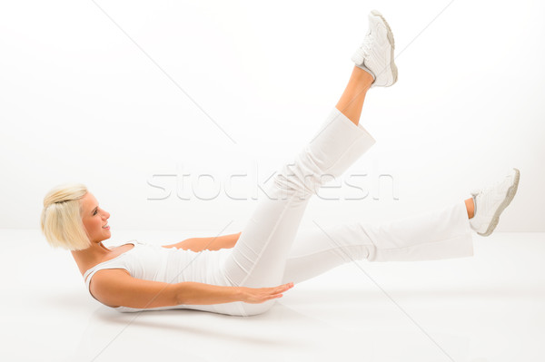 Mujer ejercicio abdomen músculo blanco fitness Foto stock © CandyboxPhoto