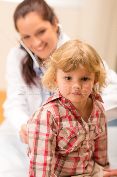 Pediatrician examine child girl with stethoscope Stock photo © CandyboxPhoto