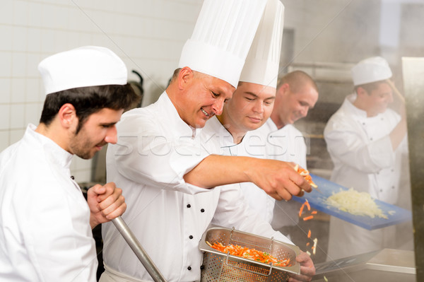 Two professional chefs cooking in kitchen Stock photo © CandyboxPhoto