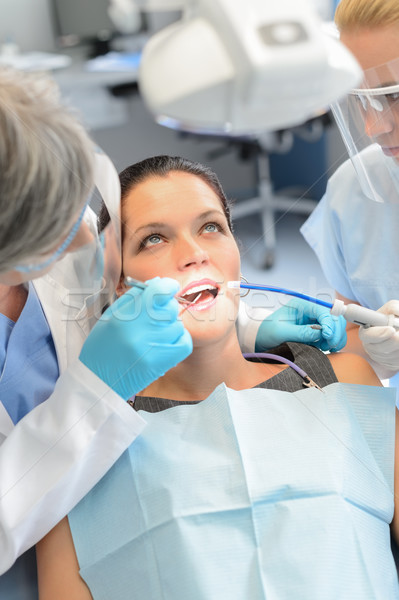 Dental team checkup woman patient teeth Stock photo © CandyboxPhoto