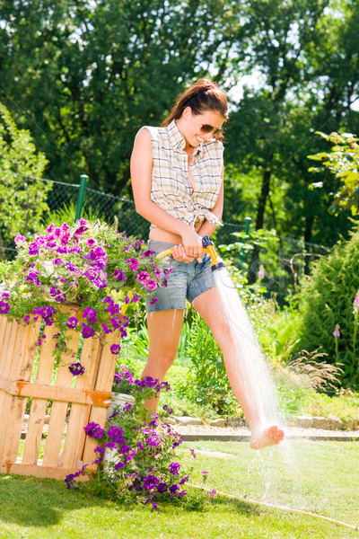 Summer garden smiling woman watering hose flower Stock photo © CandyboxPhoto