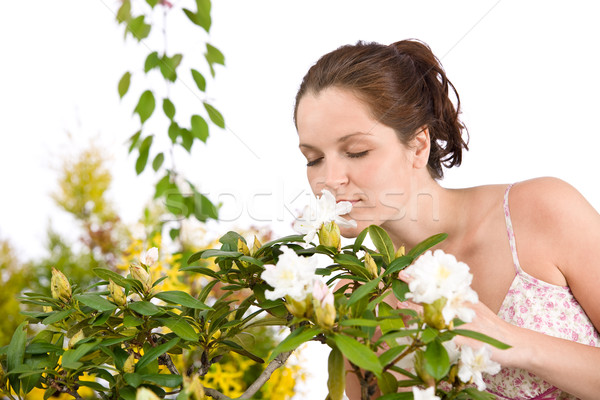 Stock photo: Portrait of woman smelling blossom of Rhododendron flower
