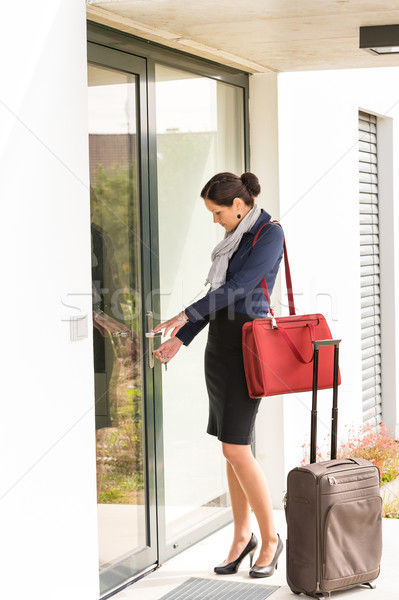 Young businesswoman locking door traveling luggage leaving Stock photo © CandyboxPhoto