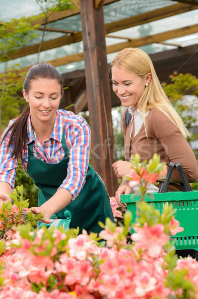 Gardener woman advising customer buying plants Stock photo © CandyboxPhoto