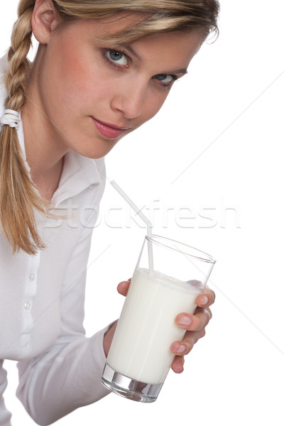 Stock photo: Healthy lifestyle series - Blond woman holding glass of milk