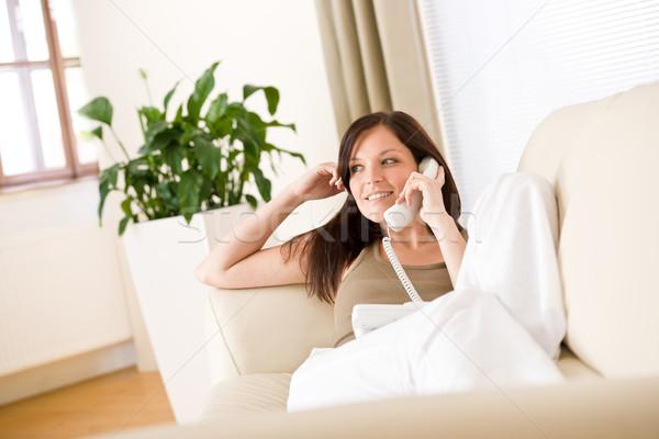 Stok fotoğraf: Telefon · ev · kadın · çağrı · oturma · odası · telefon