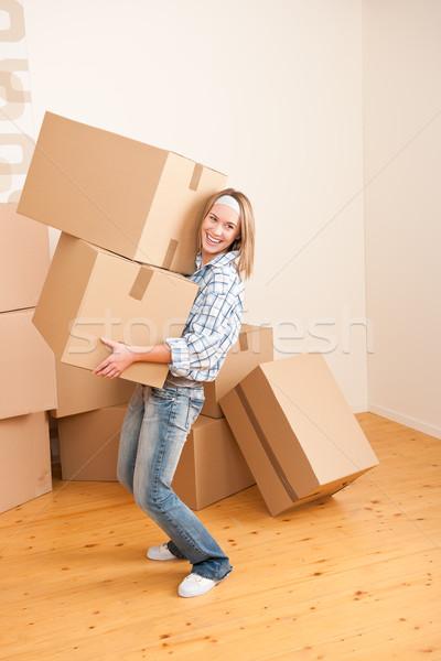 Moving house: Woman holding big carton box Stock photo © CandyboxPhoto