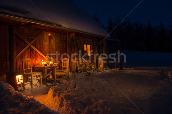 Cozy wooden cottage in dark winter forest  Stock photo © CandyboxPhoto