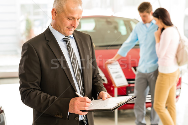 Caucasian salesman in car showroom Stock photo © CandyboxPhoto