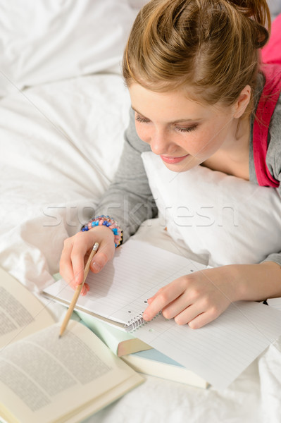 Teenage girl concentrating on studying in bed Stock photo © CandyboxPhoto
