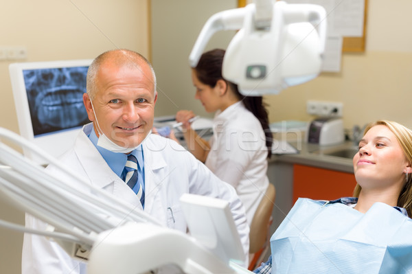 Friendly dentist with female patient dental office Stock photo © CandyboxPhoto
