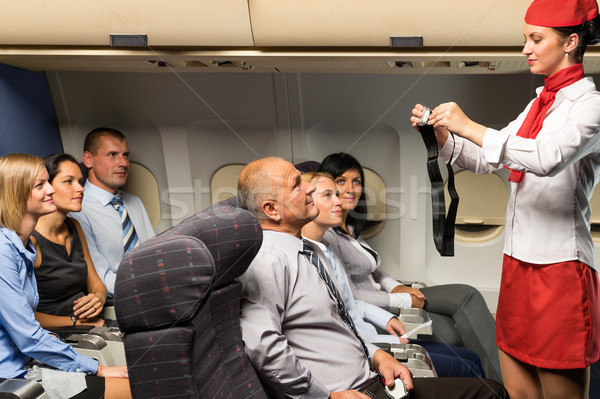 Flight attendant demo fastening seat belt airplane Stock photo © CandyboxPhoto