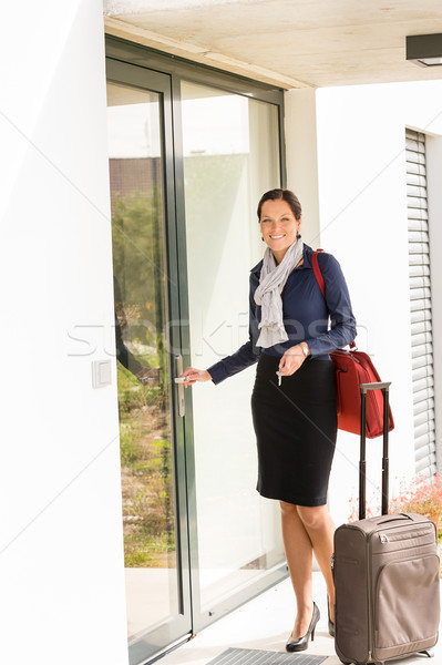 Smiling woman business flight attendant arriving home Stock photo © CandyboxPhoto