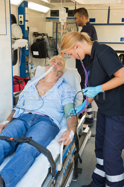 Paramedical team examining patient on stretcher Stock photo © CandyboxPhoto