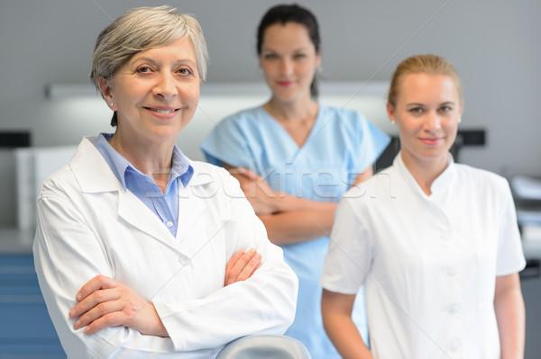 Médico profissional equipe mulher cirurgia dentária três Foto stock © CandyboxPhoto