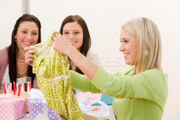 Stock photo: Birthday party - woman unwrap present, surprise