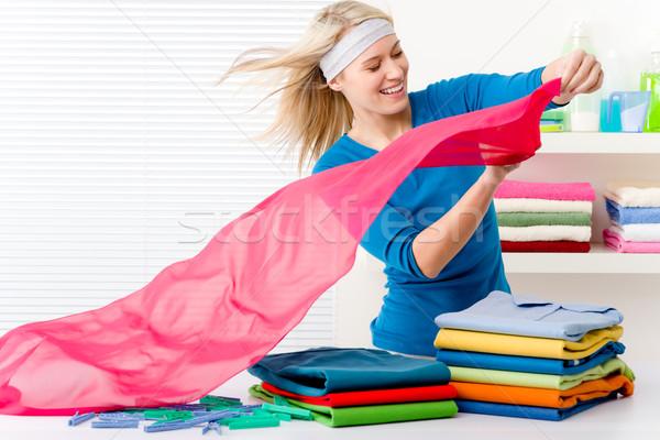 Laundry - woman folding clothes Stock photo © CandyboxPhoto