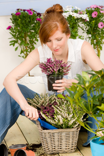 Summer garden terrace redhead woman potted flower Stock photo © CandyboxPhoto
